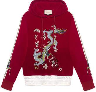 Velvet sweatshirt with dragon appliqué $1,980 thestylecure.com