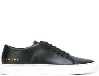 Common Projects lace-up sneakers $334.65 thestylecure.com