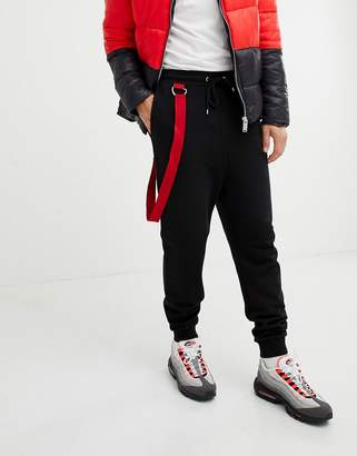 Asos DESIGN drop crotch joggers with taping in black