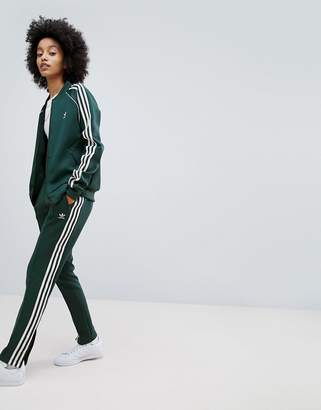adidas adicolor Three Stripe Track Pants In Green