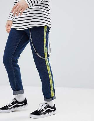 Asos DESIGN Slim Jeans In Indigo With Side Stripe Text