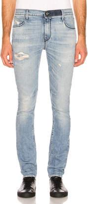 RtA Distressed Jeans in Super Light Vintage   FWRD
