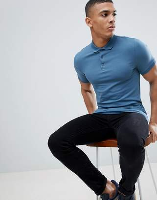 Asos DESIGN longline muscle fit jersey polo with curved hem in blue