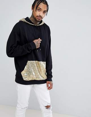 Asos DESIGN Oversized Longline Hoodie With Gold Sequin Pocket And Hood