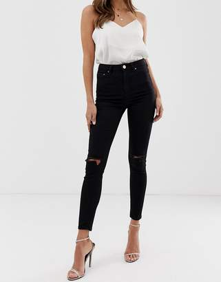 Asos DESIGN Ridley high waist skinny jeans in clean black with ripped knees