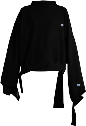 VETEMENTS X Champion oversized cotton-blend sweatshirt $880 thestylecure.com