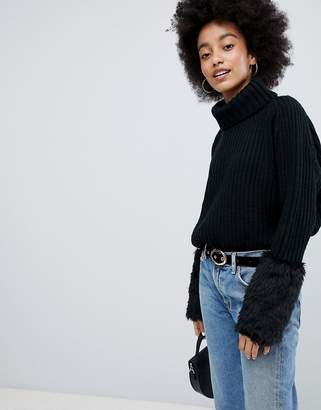 Lasula Roll Neck Sweater With Faux Fur Cuffs