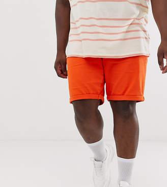 Asos Design DESIGN Plus slim denim shorts in orange