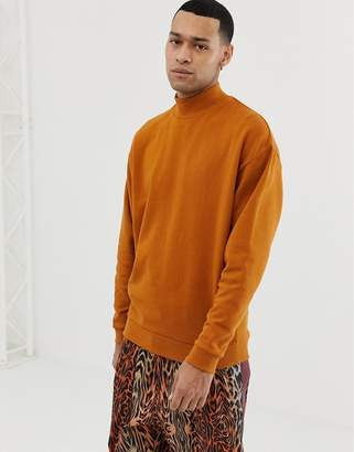 Asos DESIGN oversized sweatshirt with turtleneck in rust