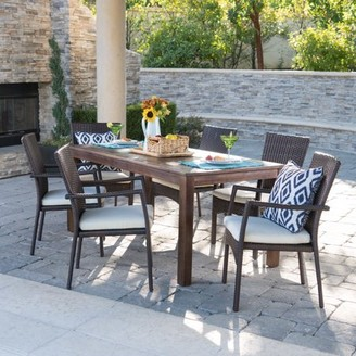 Noble House Deacon Outdoor 7 Piece Dining Set with Wood Table and Wicker Dining Chairs with Cushions, Dark Brown, Brown, Creme
