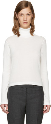 Thom Browne White Long Sleeve Turtleneck $390 thestylecure.com