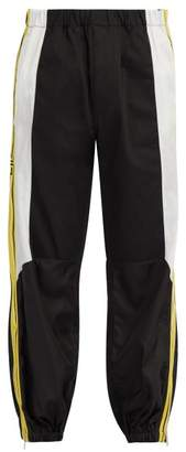 Givenchy Logo Tape Cotton Cargo Track Pants - Mens - Black