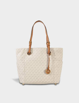 Free Returns At Monnier Freres Michael Kors Jet Set Item Ew Signature Tote Bag In Vanilla Monogrammed Canvas