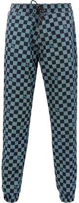 Andrea Crews checkerboard track pants