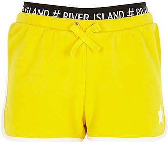 River Island Girls yellow RI waistband star runner shorts