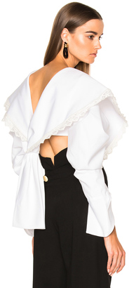 JACQUEMUS Cropped Long Sleeve Blouse $1,093 thestylecure.com