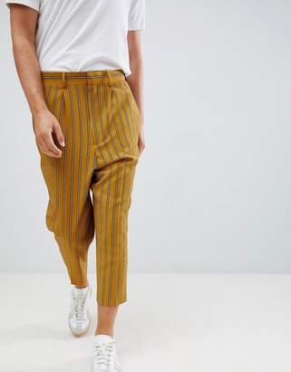 Asos Design DESIGN drop crotch tapered smart joggers in yellow pinstripe
