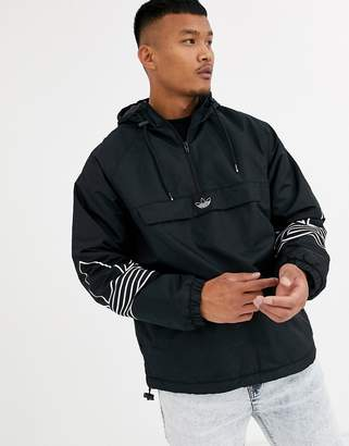 adidas fleece lined overhead jacket with arm trefoil print in black
