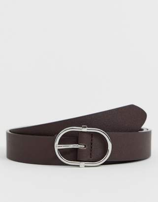 Asos Design DESIGN faux leather slim belt in brown with silver oval buckle