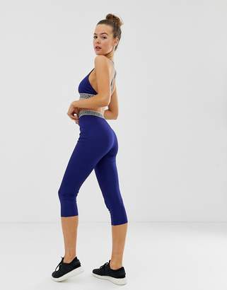 Missguided gym sports leggings in blue with printed waistband