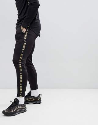 SikSilk cropped jogger in black with gold side stripe