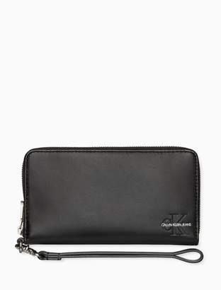 Calvin Klein monogram logo leather zip phone wallet