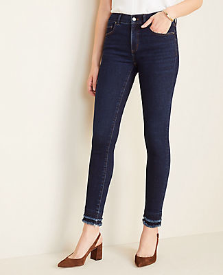 Ann Taylor Petite Sculpting Pockets Frayed Skinny Jeans in Classic Mid Wash