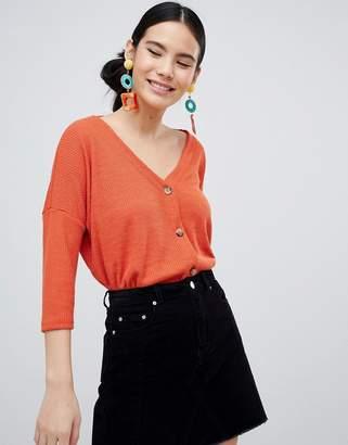 New Look button through top in orange