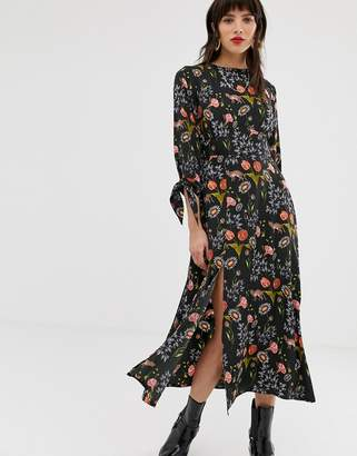 Neon Rose midaxi tea dress with tie cuffs and side split in botanical print