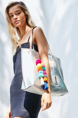 Urban Outfitters Reversible Pompom Tote Bag $59 thestylecure.com
