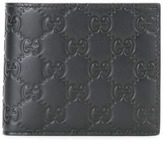 Gucci embossed logo flat wallet