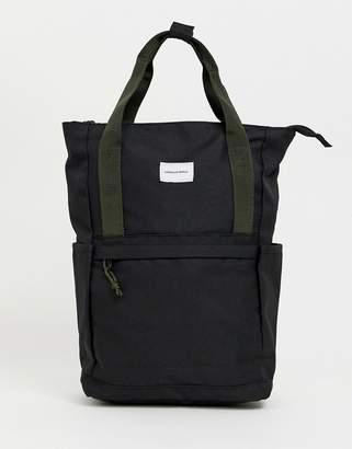 Asos Design DESIGN backpack in black with green straps