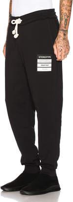 Maison Margiela Stereotype Sweatpants in Black   FWRD