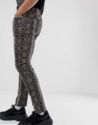 Asos Design DESIGN skinny jeans in snake print