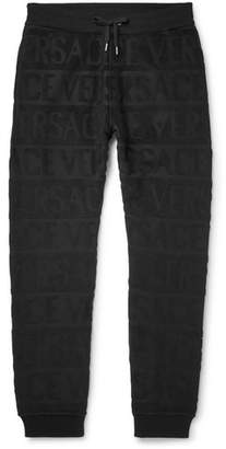 Versace Slim-Fit Tapered Logo-Jacquard Cotton-Terry Sweatpants - Men - Black
