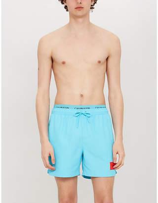 914543d6fd Calvin Klein Logo-waist mesh-lined drawstring swim shorts