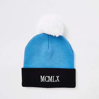 River Island Blue embroidered bobble beanie hat