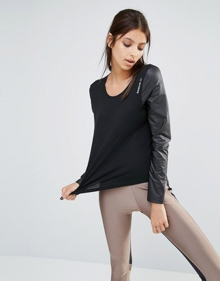 Reebok Slouchy Fit T-Shirt With Leather Look Sleeves $43 thestylecure.com