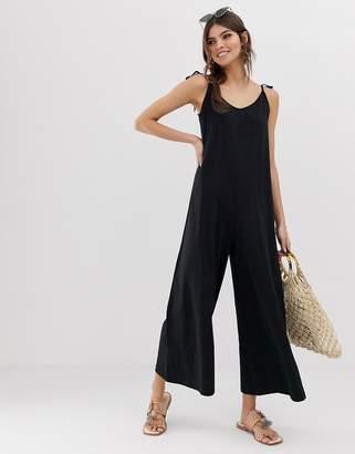 Asos Design DESIGN minimal jumpsuit with tie back in linen look
