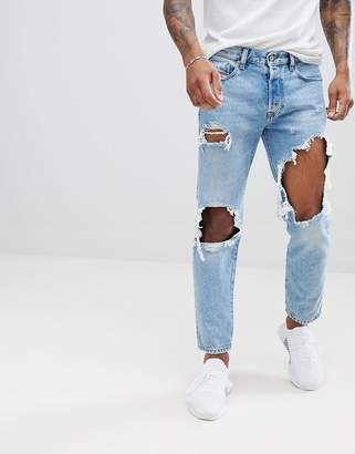 Diesel Mharky 90s fit distressed jeans in 0076m light wash