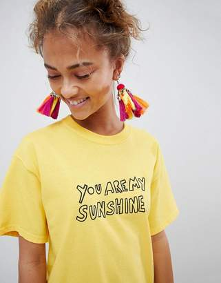 Asos DESIGN Statement Festival Pom And Tassel Chandelier Earrings