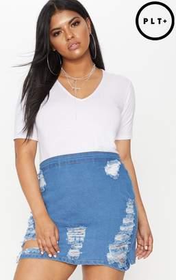PrettyLittleThing Plus Mid Wash Distressed Denim Mini Skirt