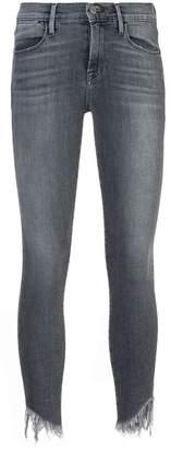 Frame frayed skinny jeans