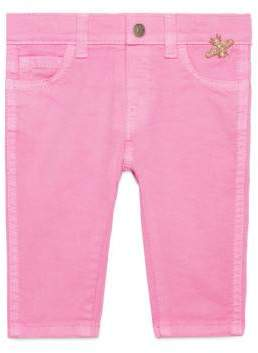 Gucci Baby stretch denim pant with bee