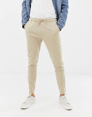 Asos Design DESIGN skinny chinos in putty with elastic waist