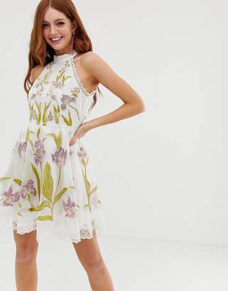 Asos Design DESIGN high neck mini dress with cut outs and embroidery and lace