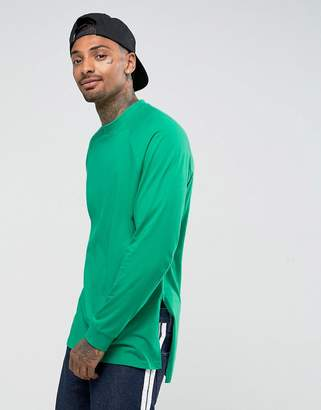 Asos DESIGN Oversized Long Sleeve T-Shirt With Side Splits And Cuffs In Green