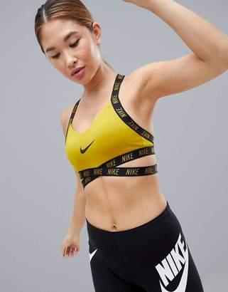 1955c73820923 Nike Training Indy Logo Bra In Mustard