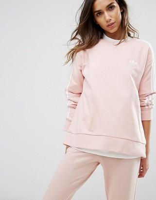 Adidas adidas Originals Pink Three Stripe Sweatshirt $60 thestylecure.com