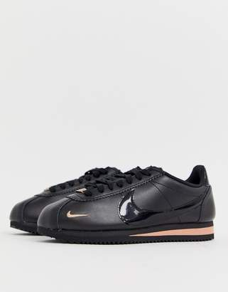 7f3f2d0f594c5 Nike Cortez trainers in black and rose gold